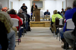 Brian Bartley with the National Flood Insurance Program speaks during a public forum for flood victims at Rose City Baptist Church on Thursday evening. The church itself is still repairing their flood damages.  Photo taken Thursday 1/4/18 Ryan Pelham/The Enterprise