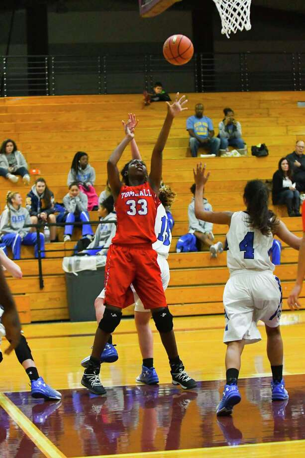 Tomball vs  New Caney Girls Basketball Caption Tomball No.33 Christina Thomas    was key in  scoring and rebounding ,  in the game against New Caney , winning 47 to 35 In the girls basketball Tournament at Waller high. 12/29/2017 Photo: Tony Gaines/ HCN, Photographer