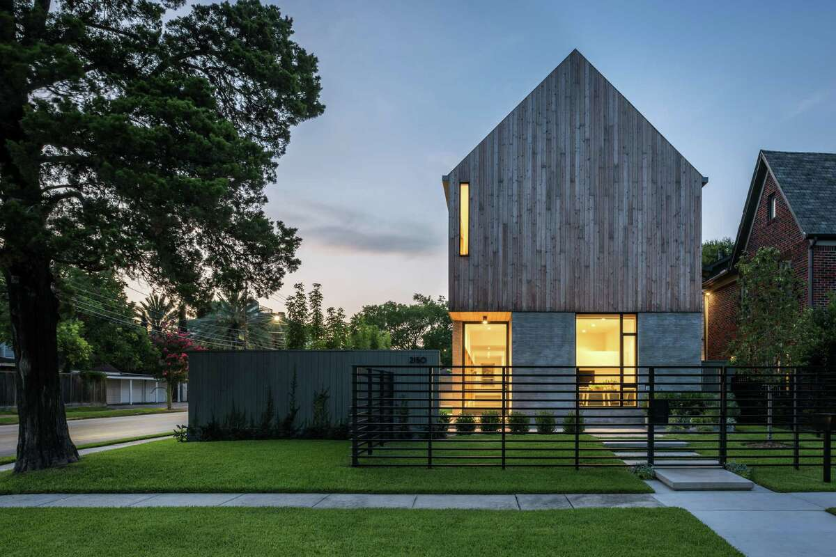 As they worked with their architect-son Michael, Chris and Catherine Viviano described the home they wanted as a modern barn. The home's exterior has concrete brick on the lower level and larch wood cladding on the upper level.
