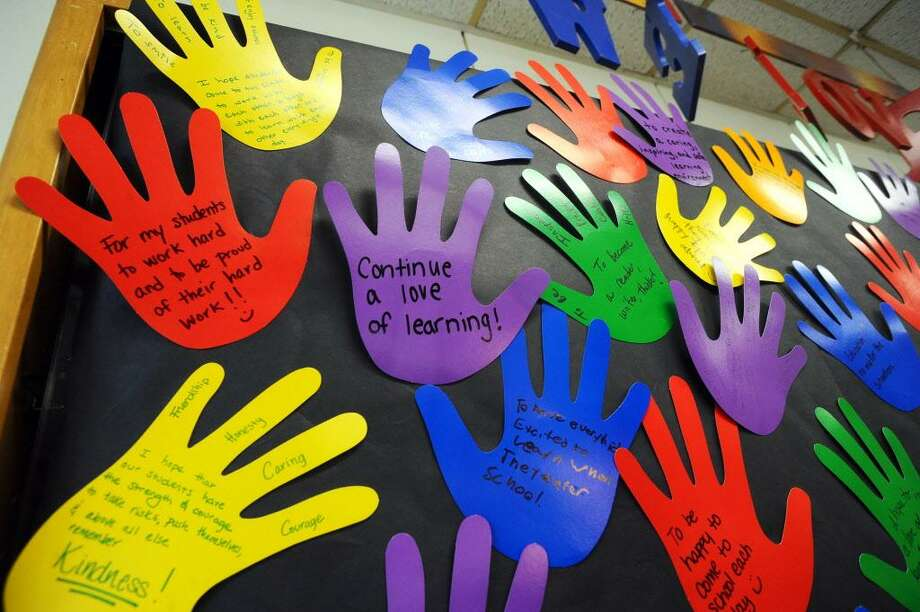 Handprints, which were made by teachers and list their hopes and dreams for their new students, line the entryway to Stillmeadow Elementary School in Stamford, Conn. on Wednesday, August 30, 2017. Photo: Michael Cummo / Hearst Connecticut Media / Stamford Advocate