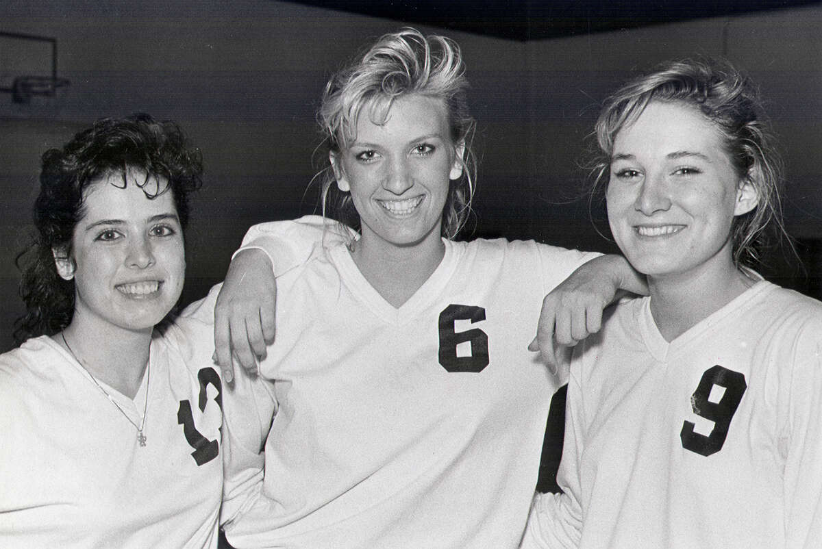 Churchill volleyball players Debbie Sanchez (13), Kristen Sparks (9), and Rachel Witliff (6) in 1988.