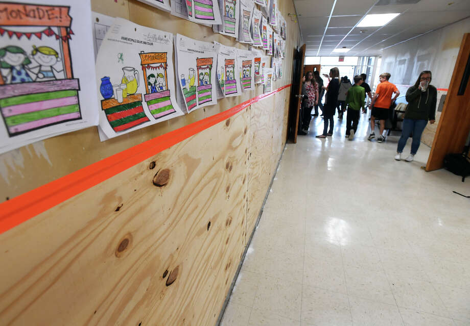 Middle school students walk through a storm damaged hallway at Orangefield High School on Tuesday. Due to several classrooms being damaged fromTropical Storm Harvey, teachers are holding class in any available space.     Photo taken Tuesday, December 19, 2017 Guiseppe Barranco/The Enterprise Photo: Guiseppe Barranco, Photo Editor / Guiseppe Barranco ©