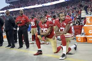 FILE - In this Sept. 12, 2016, file photo, San Francisco 49ers safety Eric Reid (35) and quarterback Colin Kaepernick (7) kneel during the national anthem before an NFL football game against the Los Angeles Rams in Santa Clara, Calif.  Teams sign quarterbacks left and right, But Kaepernick is kryptonite. (AP Photo/Marcio Jose Sanchez, File)