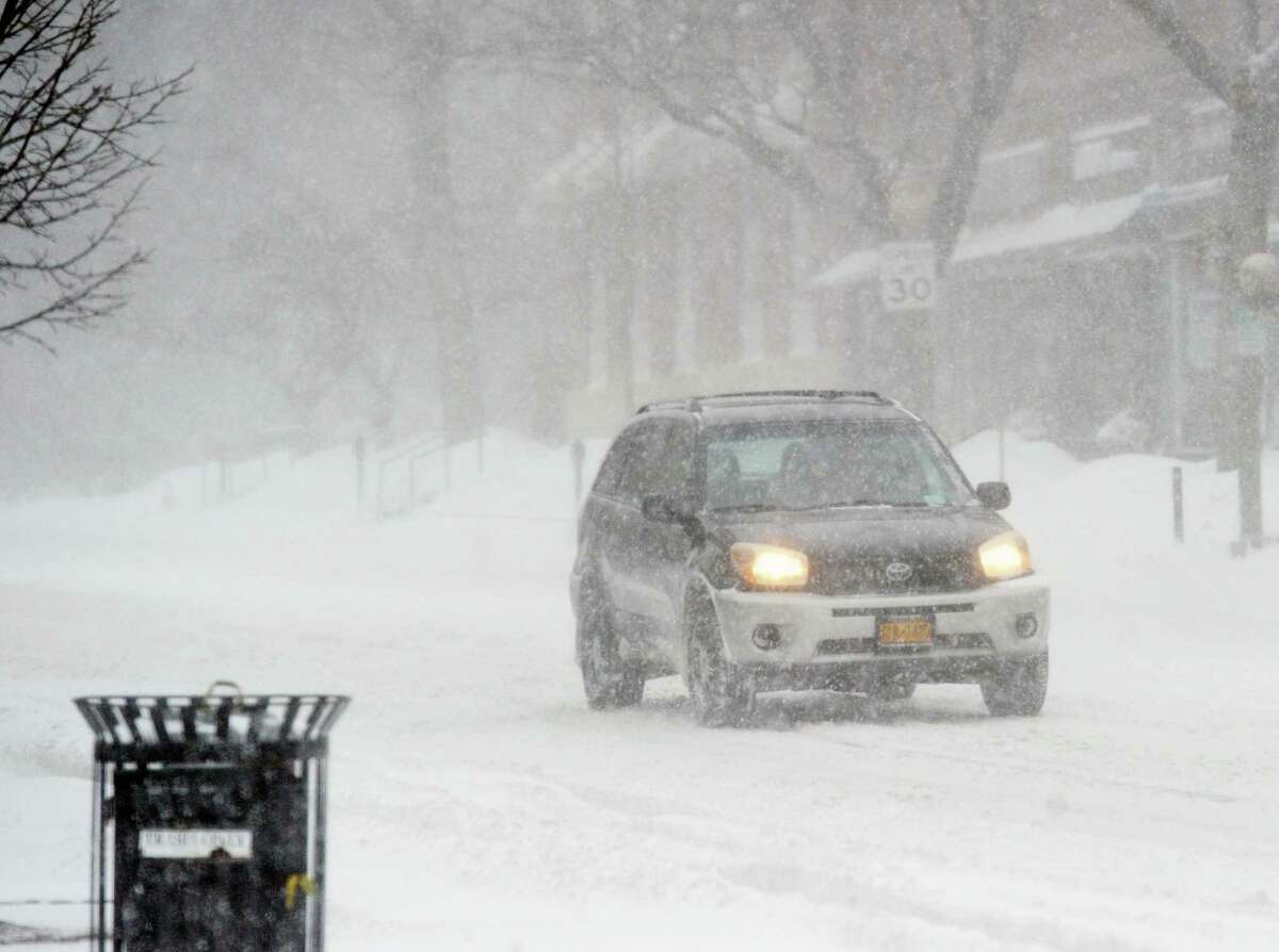 A driver makes it through the snowstorm that hit Greenwich last week.