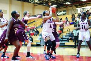 Dawson's Sydni John-Baptiste (31) puts up a shot against George Ranch Wednesday, Jan 3 at Dawson High School.
