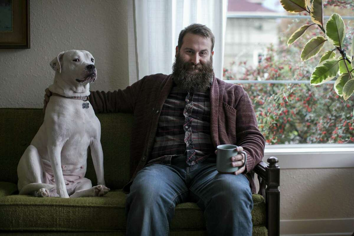 """Adam White, a nursing student and former banker, with his dog Maggie in Portland, Ore., Nov. 14, 2017. """"When we notice that our boys are gifted in math and science and they say, I want to be a doctor when I grow up, we could say, That's great, you could even be a nurse if you wanted to!'"""", said White of nursing."""