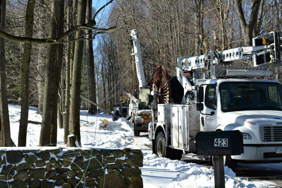 "Line crews from Norwalk, Conn.-based Frontier Communications at work on a frigid Friday, Jan. 5, 2018, restoring service to a home in the Silvermine section of New Canaan, a day after the so-called ""bomb cyclone"" hit the region with blizzard conditions. Photo: Alexander Soule / Hearst Connecticut Media / Stamford Advocate"