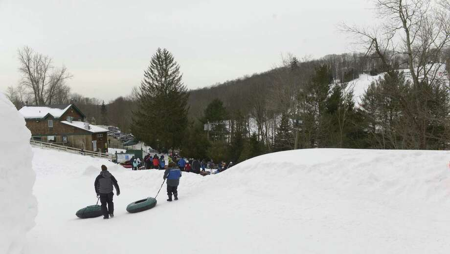 Snow tubers head back to the lift line after completing a run the at Woodbury Ski Area, in Woodbury, Conn, on Saturday, February 21, 2015. The area that was last open for the 2014-15 season is now for sale. Photo: H John Voorhees III / H John Voorhees III / The News-Times