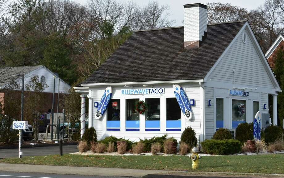 "205 Boston Post Road, Darien — The drive-through hut is open anew at the eastern edge of Darien on the Norwalk border, with Blue Wave Taco opening last month in the former home of Palmwich, Real Food Drive Thru at 205 Boston Post Road. The Blue Wave Taco menu includes Cali-style tacos, burritos and other ""killer beach chow"" in the words of its Facebook page. The Greenwich-based private equity firm Palm Ventures won last month rights to the Blue Wave Taco trademark. Photo: /"