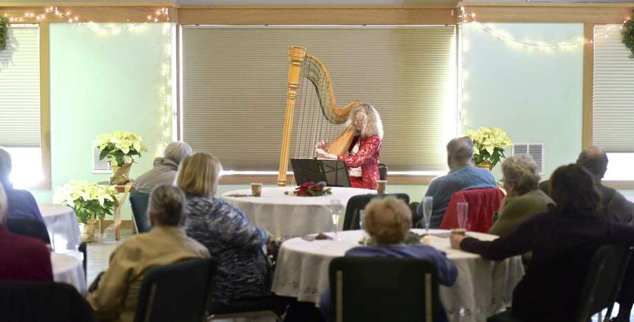 The Redding Heritage Center hosted harpist Rebecca Swett, of Fairfield, for a solo concert at the Community Center on Wednesday afternoon, December 20, 2017, in Redding, Conn. Swett split her performance between classical compsitions and holiday music. Photo: H John Voorhees III / Hearst Connecticut Media / The News-Times