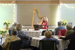 The Redding Heritage Center hosted harpist Rebecca Swett, of Fairfield, for a solo concert at the Community Center on Wednesday afternoon, December 20, 2017, in Redding, Conn. Swett split her performance between classical compsitions and holiday music.