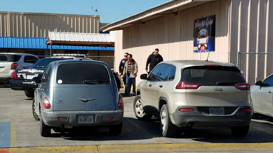 A man is taken into custody on Friday, Jan. 5, 2018 after law enforcement raided the Magic Spin maquinita located at West Calton Road and Gallagher Avenue. Photo: Cesar G. Rodriguez/Laredo Morning Times
