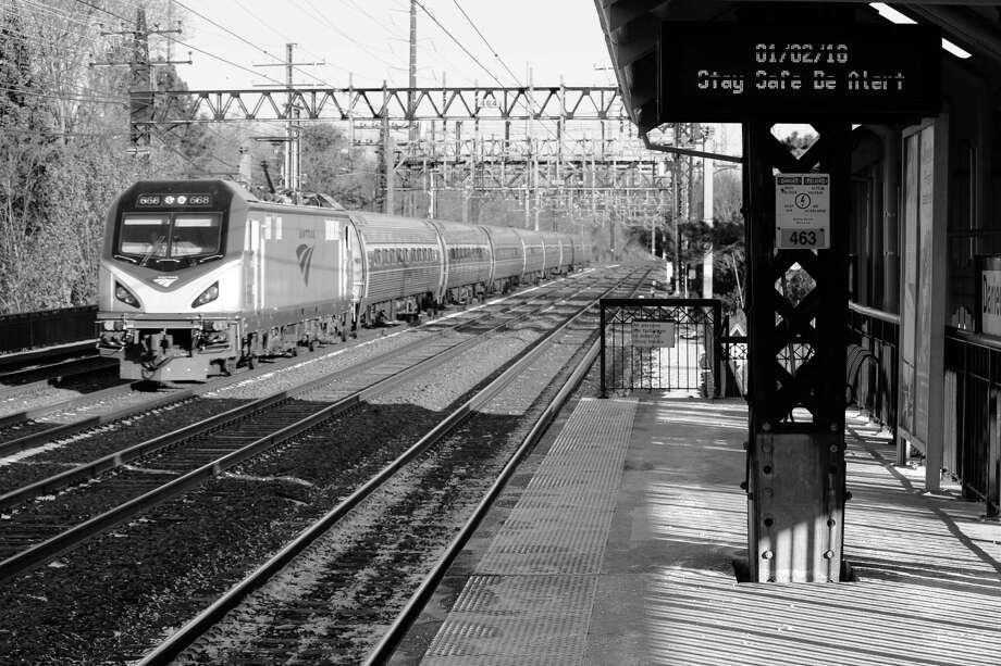 An Amtrak train travels through Darien Train Station on New Year's Day. Photo: Justin Papp / Hearst Connecticut Media / Darien News