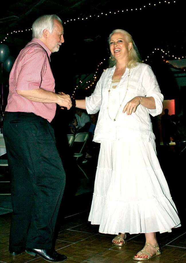 SPECTRUM/Otto Penzler and Lisa Atkinson of Kent relish their spin on the new dance floo during the June 12, 2010 Kent Volunteer Fire Department's firemen's ball at the Kent station house. Photo: Trish Haldin / The News-Times Freelance