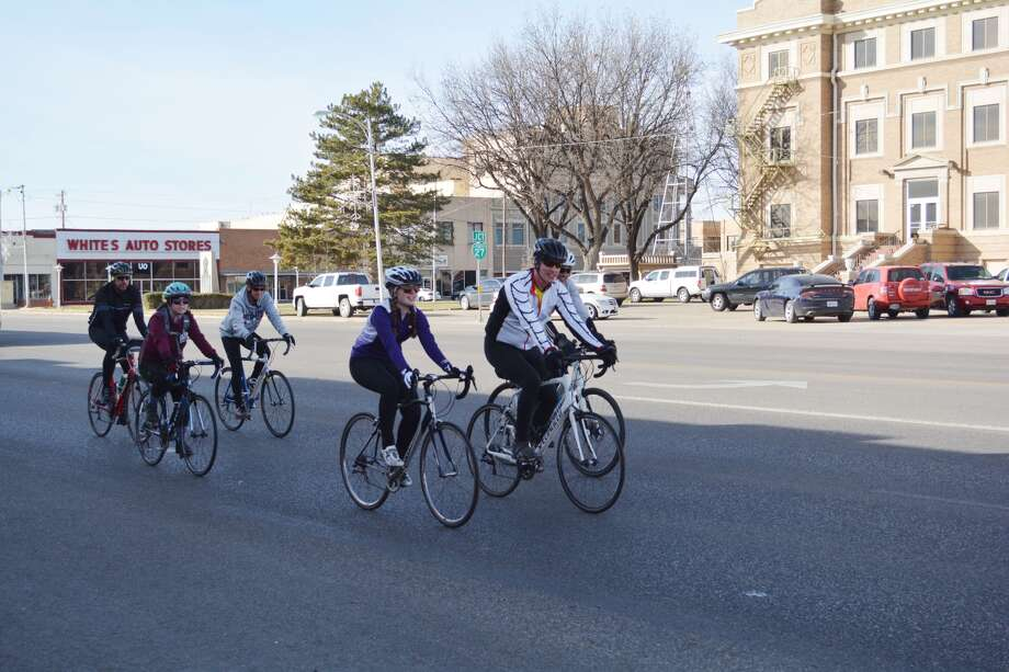 Six of the eight participants in Hardin-Simmons University's Bike Ride Across Texas cross in front of the Hale County courthouse Wednesday afternoon. The group started their trek Wednesday morning in Farwell, Texas and are continuing through the state, ending at Surfside Beach, Jan. 12. Photo: William Carroll, Plainview Herald