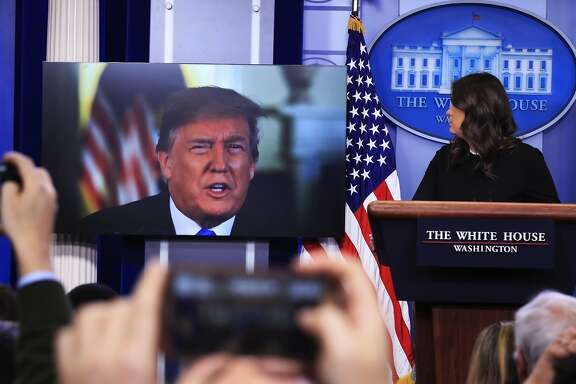 President Donald Trump speaks via a video monitor to journalists in the Brady press briefing at the White House in Washington during a press briefing with press secretary Sarah Huckabee Sanders, Thursday, Jan. 4, 2018. (AP Photo/Manuel Balce Ceneta)