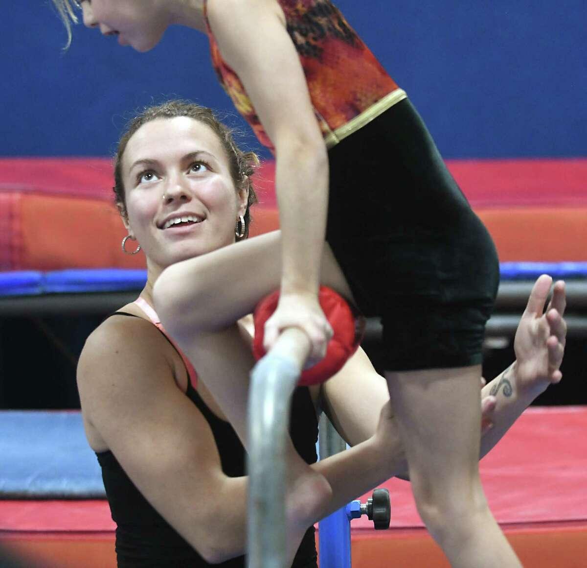 Megan Kennedy, 25, works with 8-yr-old Allison Barnett in DC Stars Gymnastics Academy on Thursday, Dec. 21, 2017 in Watervliet, N.Y. Kennedy, a gymnast who grew up training at DC Stars Gymnastics Academy, is now the owner. (Lori Van Buren / Times Union)