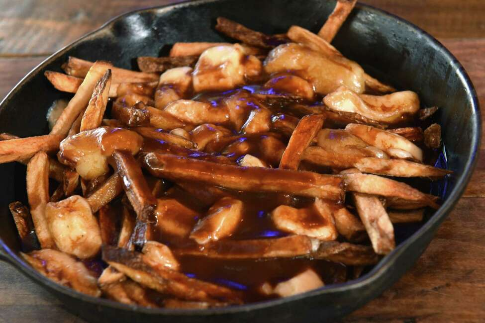 Gravy fries with smoked cheese curd at the Tipsy Moose on Wednesday, Jan. 3, 2018 in Latham, N.Y. (Lori Van Buren / Times Union)