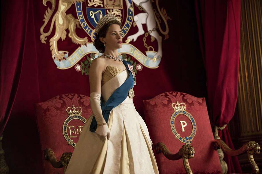 "Queen Elizabeth (Claire Foy) at Prince Philip's investiture in ""The Crown."" Netflix Inc. has become the largest supplier of new shows, increasing output from just a few programs in 2013 to dozens in 2017 in a bid to sign up more customers. The service has several movies and shows, including ""The Crown,"" competing at this weekend's Golden Globe Awards. Photo: Robert Viglasky / Netflix /TNS / Los Angeles Times"