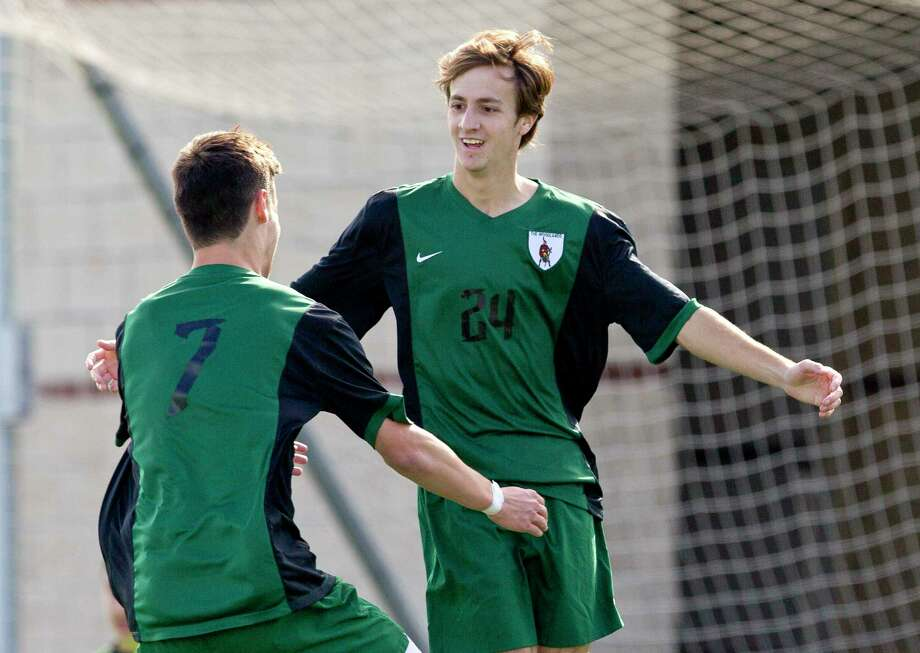 The Woodlands forward Colin Spaulding (7) celebrates with midfielder Alex Duffour (24) after his goal in the second period of a match during the Kilt Cup at Woodforest Bank Stadium, Friday, Jan. 5, 2018, in Shenandoah. Photo: Jason Fochtman, Staff Photographer / © 2017 Houston Chronicle