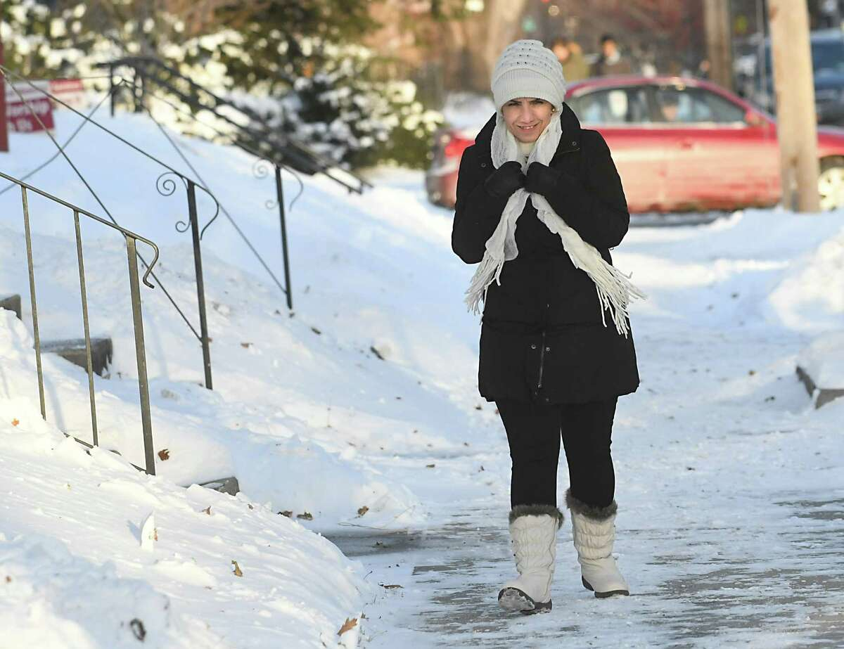 Omran Naaso, a Syrian refugee, walks down Delaware Ave. and is adjusting to the cold temperatures in Albany on Friday, Jan. 5, 2018 in Albany, N.Y. (Lori Van Buren / Times Union)