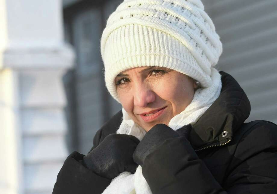 Omran Naaso, a Syrian refugee, stands outside her home  and is adjusting to the cold temperatures in Albany on Friday, Jan. 5, 2018 in Albany, N.Y. (Lori Van Buren / Times Union) Photo: Lori Van Buren, Albany Times Union / 20042581A