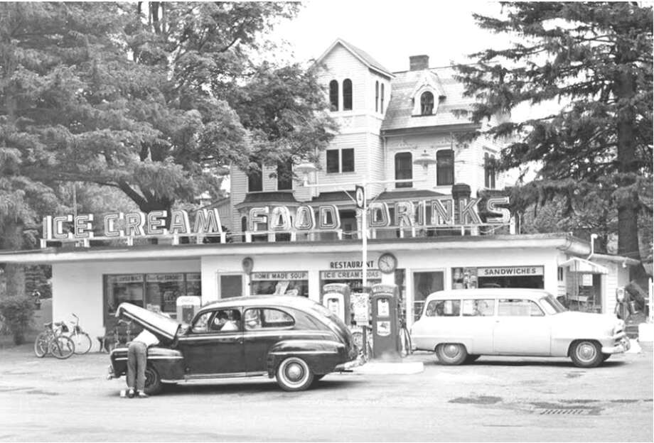 A photo of Charlie Sanders Ice Cream, a gas station and ice cream shop that is located on what is now the closed Mangia restaurant property. The old William Henry home is in the background. The Slingerland home has since been demolished, but the Slingerland family vault remains next to the property on a small piece of land owned by the town. Photo: Courtesy Of Slingerland Family