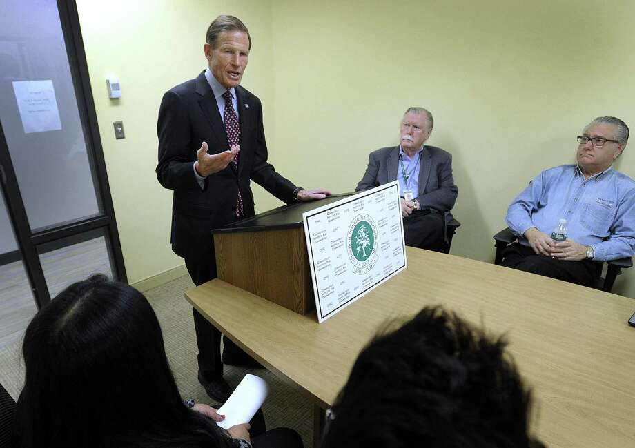 U.S. Representative Richard Blumenthal visits the Greater Danbury Community Health Center in Danbury to hear firsthand how Danbury children would be harmed should Congress fail to extend the Children's Health Insurance Program, Friday, January 5, 2018. Center is James Maloney, president of Connecticut Institute for Communities. Right is Joseph Walkovich,  advance ment  director. ] Photo: Carol Kaliff / Hearst Connecticut Media / The News-Times