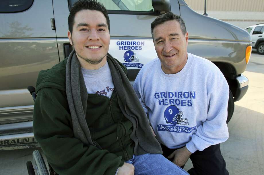 Eddie Canales formed Gridiron Heroes, which promotes safe tackling, after his son Chris was paralyzed. Photo: TOM REEL / SAN ANTONIO EXPRESS-NEWS / © 2011 San Antonio Express-News