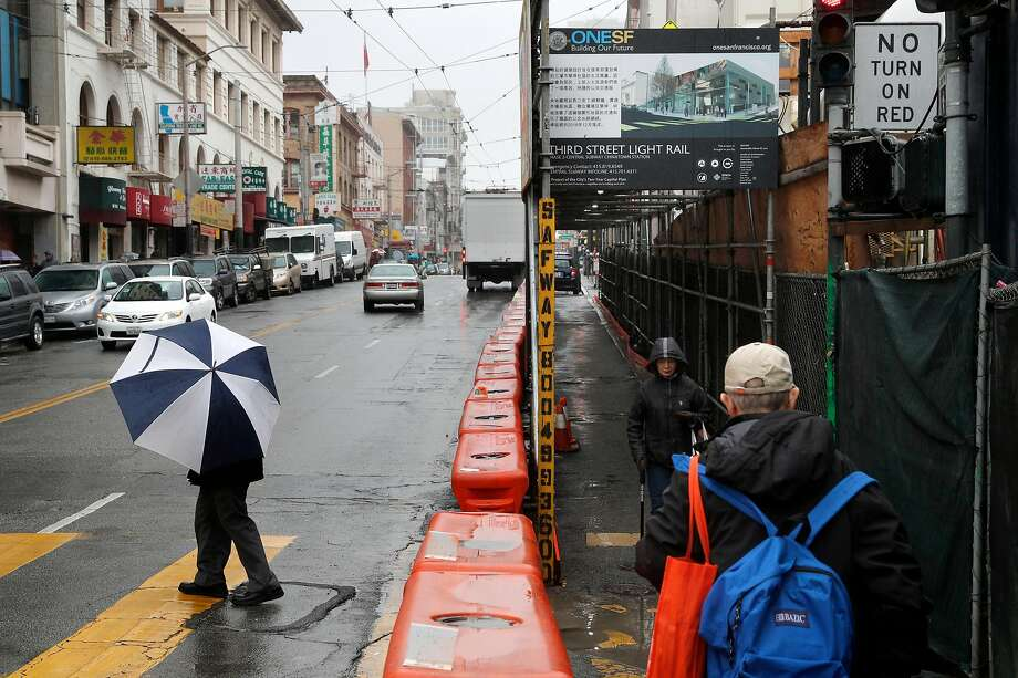 Pedestrians make their way through Chinatown in San Francisco. During an illness, columnist Caille Millner learned lessons about limited mobility. Photo: Michael Macor, The Chronicle