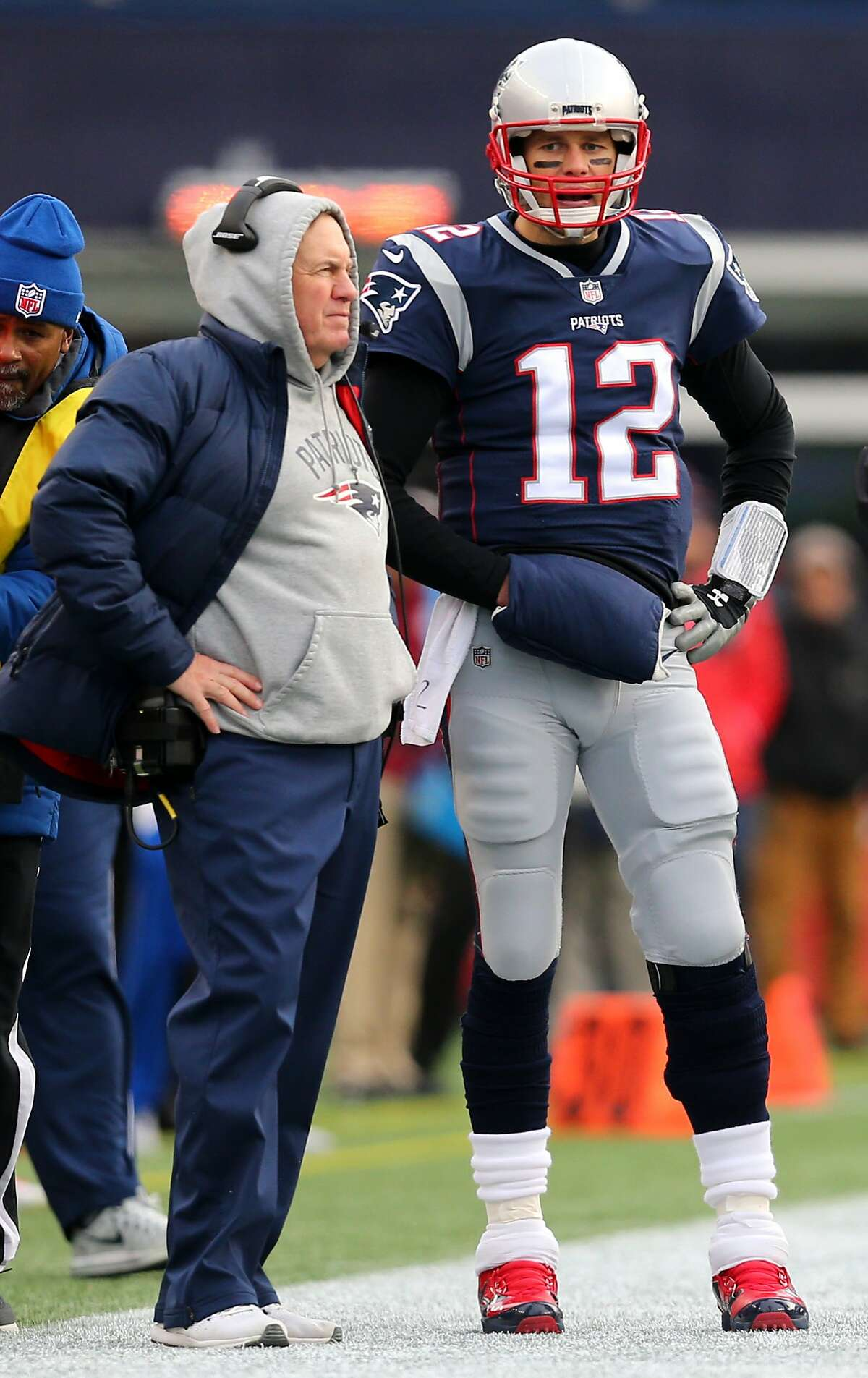 Head coach Bill Belichick of the New England Patriots stands with Tom Brady #12 during the second half against the Buffalo Bills at Gillette Stadium on December 24, 2017 in Foxboro, Massachusetts. (Photo by Maddie Meyer/Getty Images)