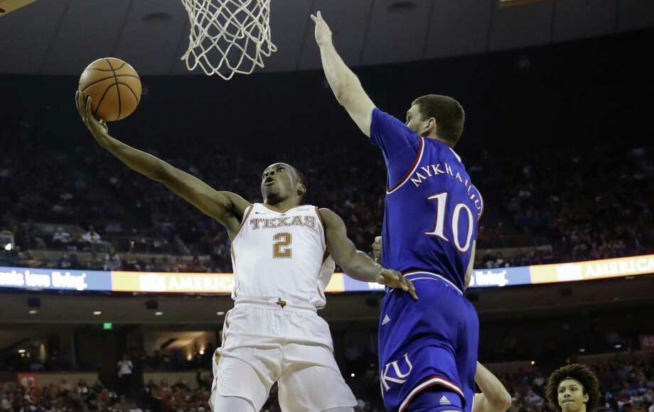 Texas guard Matt Coleman (2) drives to the basket against Kansas guard Sviatoslav Mykhailiuk (10) during the second half of an NCAA college basketball game Friday, Dec. 29, 2017, in Austin, Texas. Kansas won 92-86. (AP Photo/Eric Gay) Photo: Eric Gay, STF / Associated Press / Copyright 2017 The Associated Press. All rights reserved.