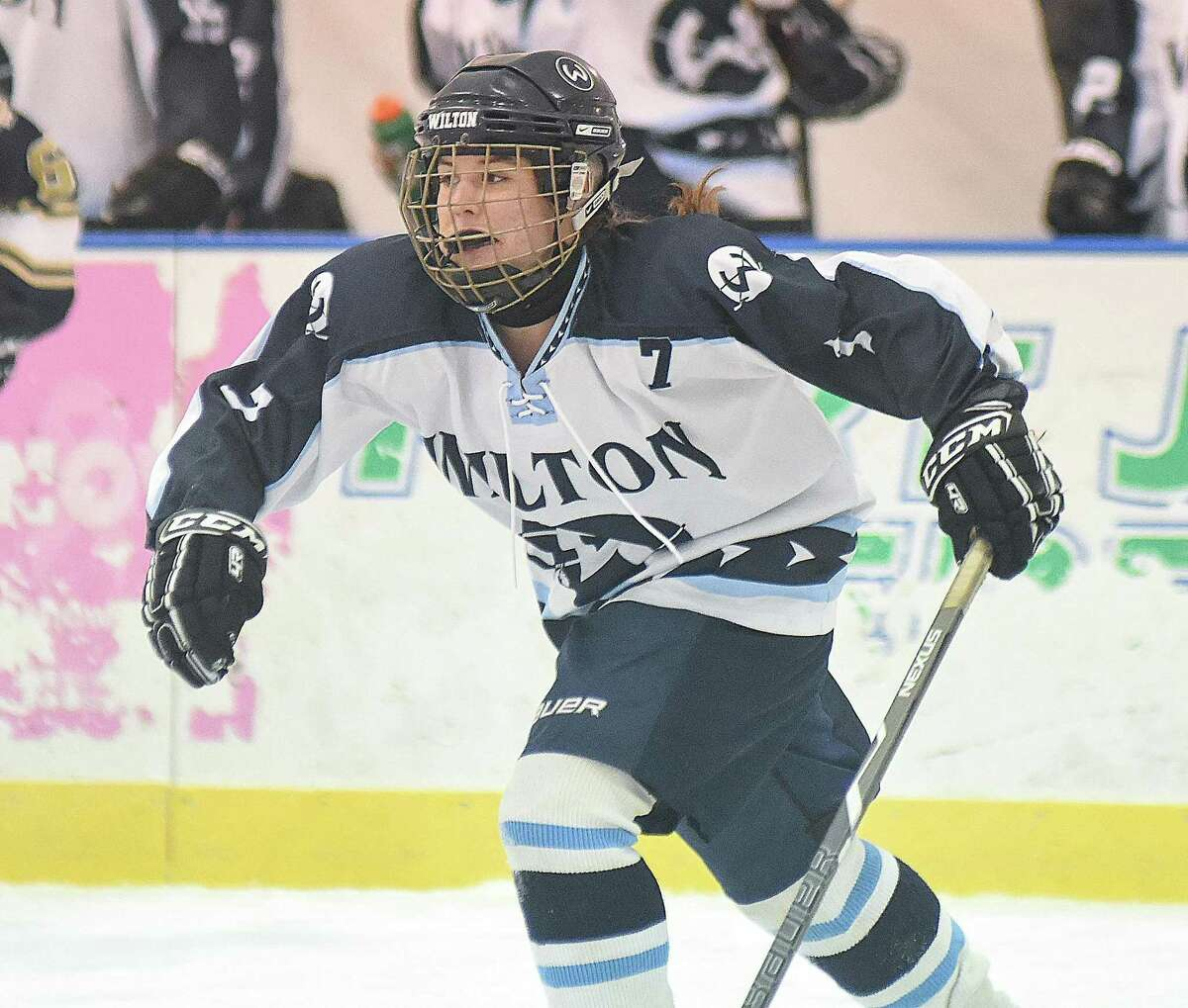 Molly Thomas of the Wilton girls hockey team skates up ice during her team's season-opening game against Notre Dame-Fairfield last weekend. 12-15-16