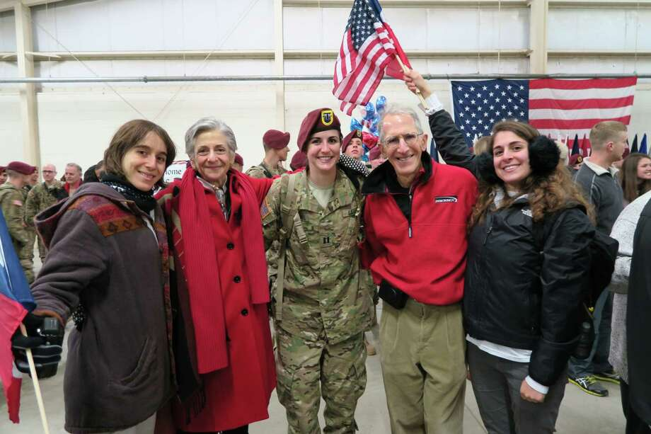 U.S. District Judge Lee H. Rosenthal, husband Gary, and her twin daughters Jessica, left, and Rachel, right, welcome back another daughter, Capt. Hannah Rosenthal, of the Army's 82nd Airborne after the first of two deployments to Afghanistan on Nov. 16, 2014. Their eldest daughter Rebecca is not pictured. Photo: Photo Courtesy Of Judge Lee H. Rosenthal