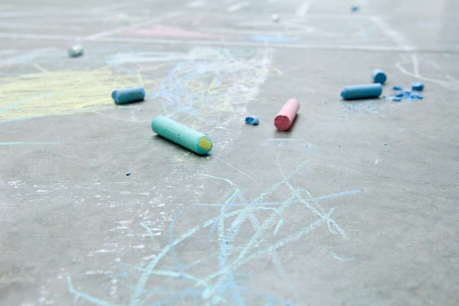"In ""The Chalk Man,"" Eddie and his friends invent a game that involves drawing little chalk figures on the ground to pass secret messages. Photo: PhotoAlto / Odilon Dimier / Getty Images"