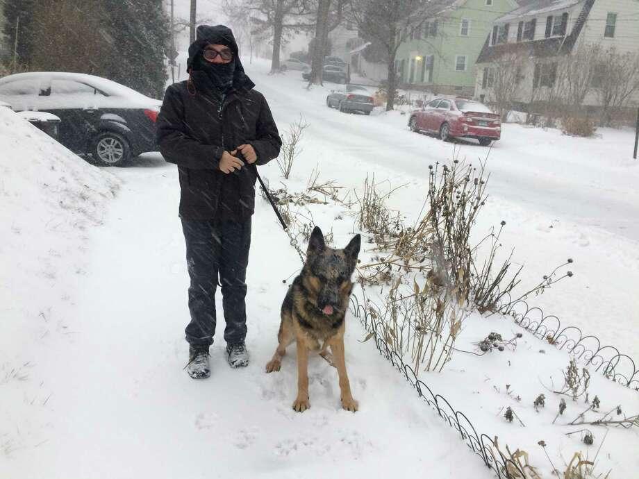 Westville resident Matt Smith walks his dog Colby Thursday morning Photo: William Kaempffer / Hearst Connecticut Media