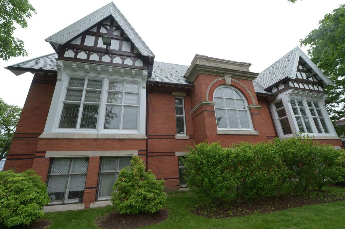The historic wing of the Norwalk Public Library main branch, as seen here in June, was built by Andrew Carnegie in 1902 as the original library for the city. Its architectural interest and charm endure as the library has grown through the years.