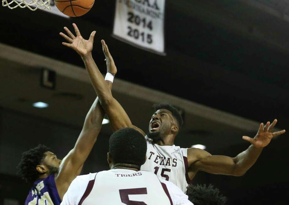 Texas Southern Tigers forward Marquis Salmon (15) is fouled by Alcorn State Braves forward Devon Brewer (50) while going for the basket during the first quarter of a Southwestern Athletic Conference game at Health & Physical Education Arena on Wednesday, Jan. 3, 2018, in Houston. ( Yi-Chin Lee / Houston Chronicle ) Photo: Yi-Chin Lee, Houston Chronicle / © 2018  Houston Chronicle