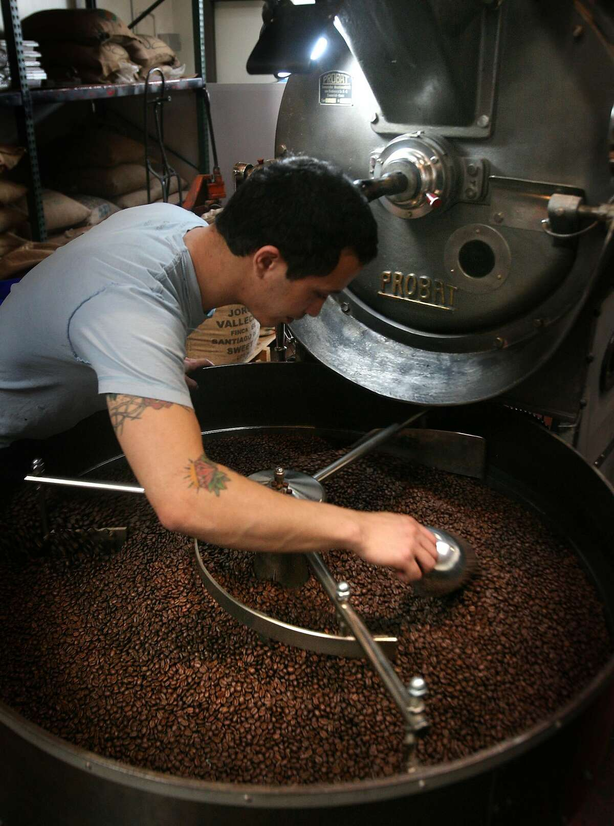 Jeremy Tooker inspects a batch of coffee he's roasting at Four Barrel Coffee, a coffee house in San Francisco, Calif. on Tuesday, March 3, 2009.