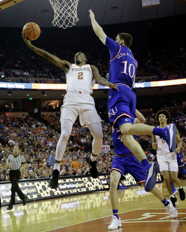 Texas guard Matt Coleman (2) drives to the basket against Kansas guard Sviatoslav Mykhailiuk (10) during the second half of an NCAA college basketball game Friday, Dec. 29, 2017, in Austin, Texas. Kansas won 92-86. (AP Photo/Eric Gay) Photo: Eric Gay, STF / Copyright 2017 The Associated Press. All rights reserved.