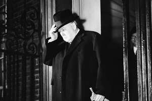 British Prime Minister Winston Churchill leaves 10 Downing Street in London on March 25, 1953, for Parliament. His leadership during WWII saved a nation — and perhaps the world.