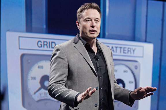 """Elon Musk, co-founder and chief executive officer of Tesla Motors Inc., speaks during the unveiling of the company's """"Powerwall' at an event in Hawthorne, California, U.S., on Thursday, April 30, 2015. Musk unveiled a suite of batteries to store electricity for homes, businesses and utilities, saying a greener power grid furthers the company's mission to provide pollution-free energy. Photographer: Tim Rue/Bloomberg"""