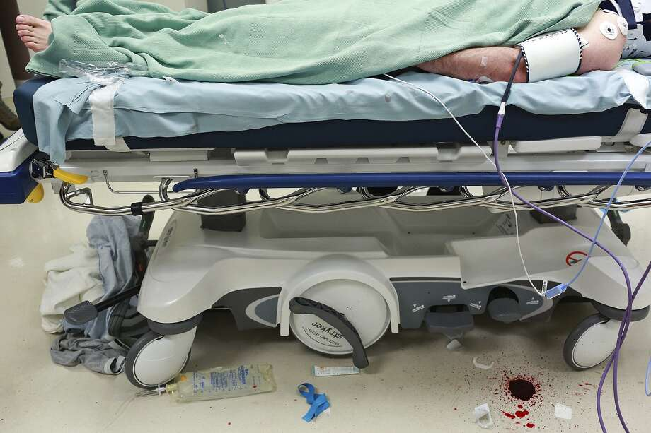 A trauma patient is treated at Brooke Army Medical Center in 2015. Brooke maintains a Level 1 trauma center, which relies on civilian patients to remain as skilled as it is. Creation of more trauma centers in the city could harm the facility. Photo: Lisa Krantz /SAN ANTONIO EXPRESS-NEWS / SAN ANTONIO EXPRESS-NEWS