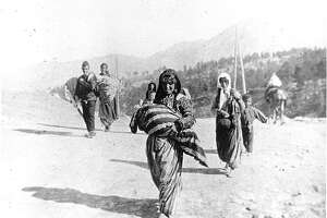 """Still from the doumentary """"Intent to Destroy"""":� Armenian deportee family on the road during the Armenian genocide.�Photo by Armin T. Wegner.� Courtesy of Armenian National Institute"""