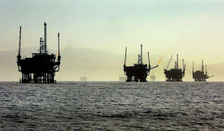 A line of off-shore oil rigs in the Santa Barbara Channel near the Federal Ecological Preserve en route to the Channel Islands National Marine Sanctuary in March 2015. The Trump administration proposed to open for exploration the largest expanse of the nation's offshore oil and natural gas reserves ever offered to global energy companies. (Al Seib/Los Angeles Times/TNS) Photo: Al Seib, FILE / Los Angeles Times