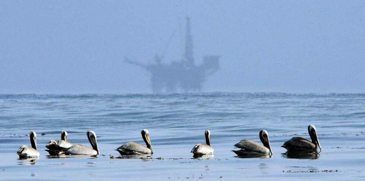In this May 13, 2010 photo, pelicans float on the water with an offshore oil platform in the background in the Santa Barbara Channel off the coast of Santa Barbara, Calif. The Trump administration on Thursday, Jan. 4, 2018 moved to vastly expand offshore drilling from the Atlantic to the Arctic oceans with a plan that would open up federal waters off the California coast for the first time in more than three decades. The Channel is one of those areas.