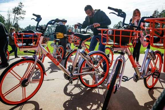 People try out bikes as The Woodlands introduces a new dockless bike sharing program, MoBike, at Town Green Park Friday, Jan. 5, 2018. The bikes don't need to be returned to a specific location at the end of a users ride and can be unlocked by a new user with phone app. ( Michael Ciaglo / Houston Chronicle)