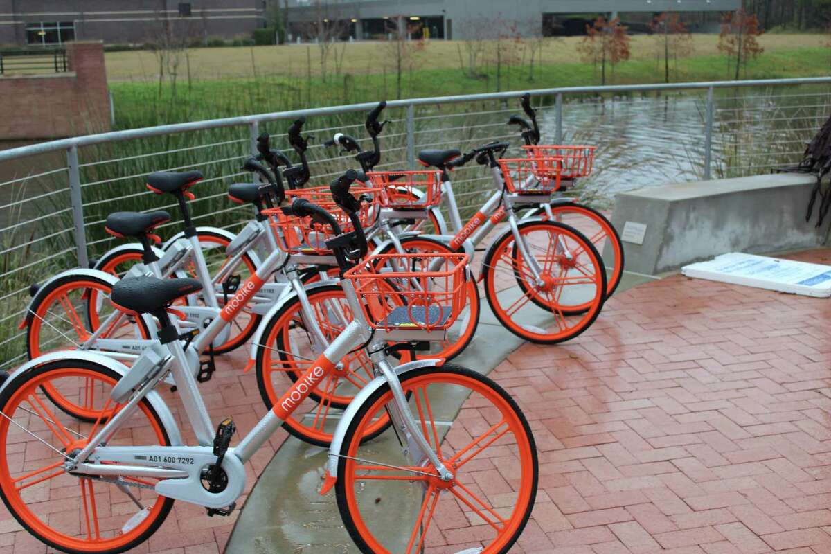 """Residents of The Woodlands and visitors to the township have a new way of getting around town by using shareable """"smart bikes."""" The Woodlands Township Board of Directors in early December approved a memorandum of understanding with a firm called Mobike to provide the smart bikes which can be shared by anyone for fee. The bikes can be rented and reserved thourhg a smart phone app that requires users to scan a QR code,which unlocks the bike and allows it to be taken out for a ride."""