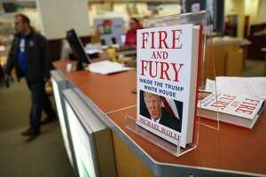 "Shoppers pass the last remaining copies of the book ""Fire and Fury: Inside the Trump White House"" by Michael Wolff at a Barnes & Noble store, Friday, Jan. 5, 2018, in Newport, Ky."