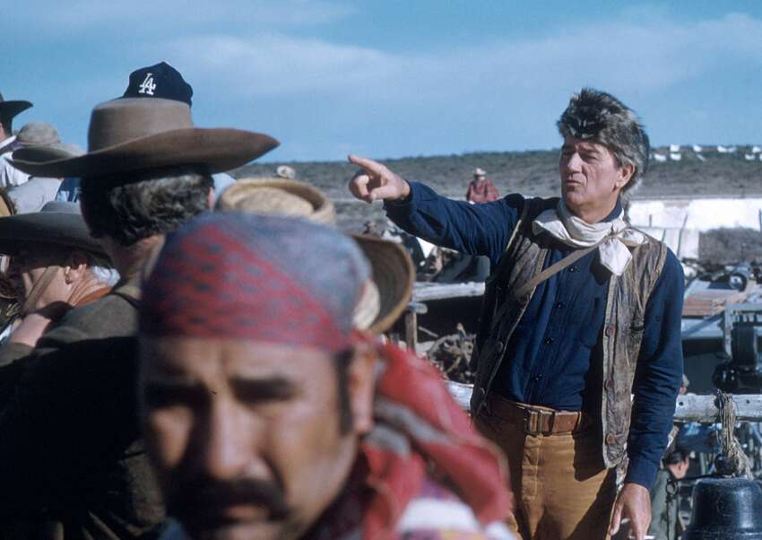 In costume (as Colonel Davy Crockett), American actor John Wayne (1907 - 1979) (right) directs crew members in the scene from his film 'The Alamo', Brackettville, Texas, 1960. (Photo by Tom Nebbia/Corbis via Getty Images)